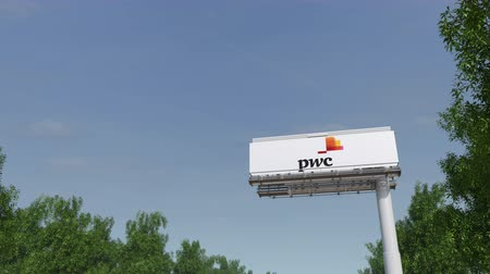 pwc : Driving towards advertising billboard with PricewaterhouseCoopers PwC logo.
