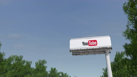 youtube : Driving towards advertising billboard with YouTube logo. Stock Footage