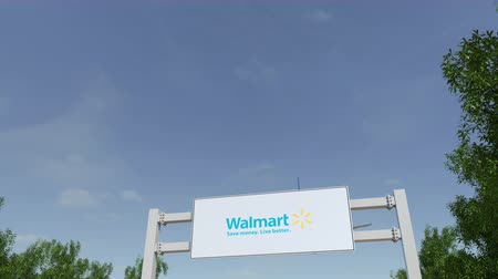 walmart : Airplane flying over advertising billboard with Walmart logo.