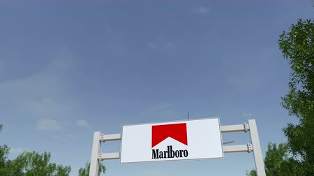 richmond : Airplane flying over advertising billboard with Marlboro logo.