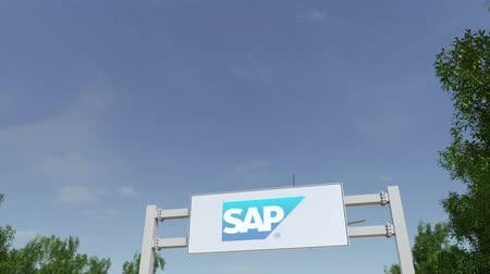 reklama : Airplane flying over advertising billboard with SAP SE logo.