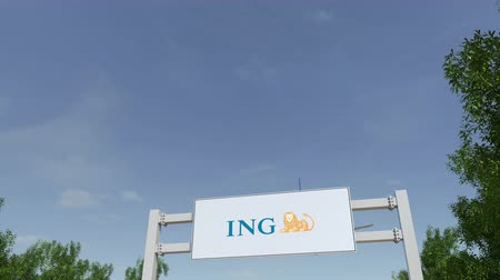 ing : Airplane flying over advertising billboard with ING Group logo.