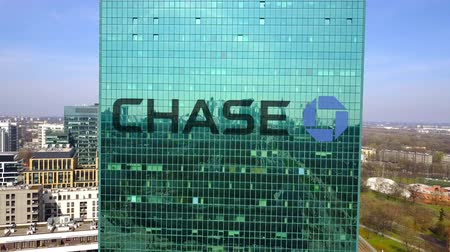honit : Aerial shot of office skyscraper with JPMorgan Chase Bank logo.