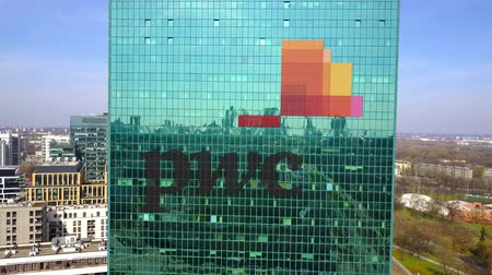 pwc : Aerial shot of office skyscraper with PricewaterhouseCoopers PwC logo. Stock Footage