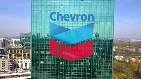 refining : Aerial shot of office skyscraper with Chevron Corporation logo. Modern office building. Editorial 3D rendering