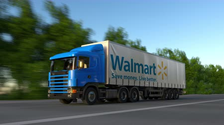 walmart : Freight semi truck with Walmart logo driving along forest road, seamless loop. Stock Footage