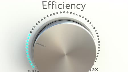 минимальный : Rotating knob with efficiency inscription. Conceptual 4K clip