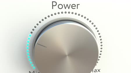 минимальный : Rotating knob with power inscription. Conceptual 4K clip