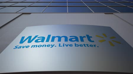 walmart : Outdoor signage board with Walmart logo. Modern office building. Editorial 3D rendering