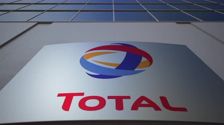 refining : Outdoor signage board with Total S.A. logo. Modern office building. Editorial 3D rendering
