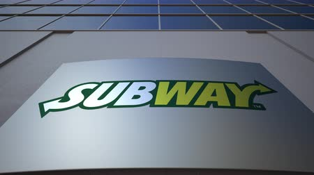 franczyza : Outdoor signage board with Subway logo. Modern office building. Editorial 3D rendering