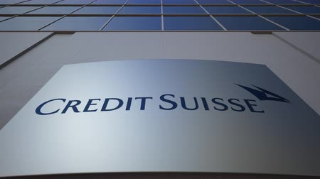credit suisse : Outdoor signage board with Credit Suisse Group logo. Modern office building. Editorial 3D rendering
