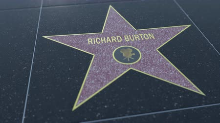 richard : Hollywood Walk of Fame star with RICHARD BURTON inscription. Editorial clip