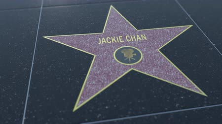 jackie chan : Hollywood Walk of Fame star with JACKIE CHAN inscription. Editorial clip