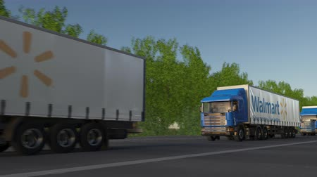 walmart : Freight semi trucks with Walmart logo driving along forest road, seamless loop. Editorial clip Stock Footage