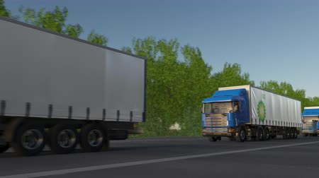 refining : Freight semi trucks with BP logo driving along forest road, seamless loop. Editorial clip Stock Footage