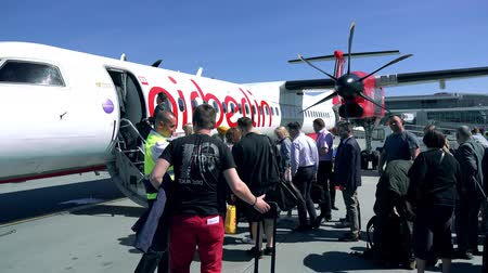 multa : WARSAW, POLAND - MAY, 18, 2017. Air Berlin propeller plane boarding at the airport. Vídeos