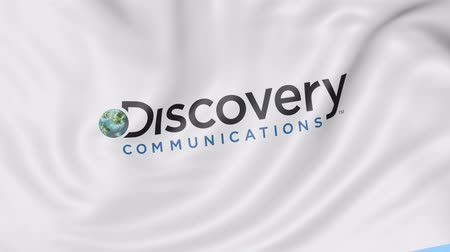 keşif : Waving flag with Discovery Communications logo. Seamless loop editorial animation