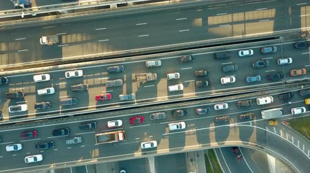 usual : Aerial top down descending shot of a traffic jam on a city highway in the rush hour. 4K video Stock Footage