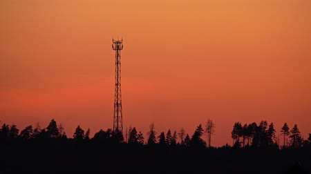emitter : Silhouette of a cell tower against orange sunset sky. 4K video Stock Footage