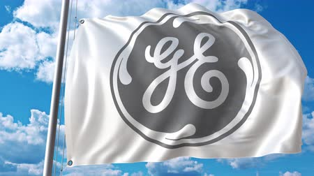 general electric : Waving flag with General Electric logo against moving clouds. 4K editorial animation Stock Footage