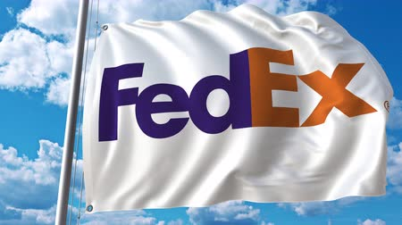 eixo : Waving flag with FedEx logo against moving clouds. 4K editorial animation