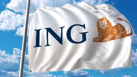 ing : Waving flag with ING logo against moving clouds. 4K editorial animation Stock mozgókép