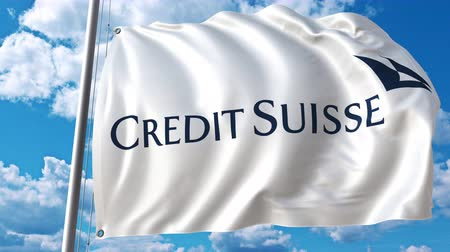 credit suisse : Waving flag with Credit Suisse logo against moving clouds. 4K editorial animation Stock Footage