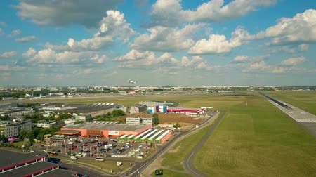 aerodrome : WARSAW, POLAND - JUNE 19, 2017. Scenic aerial shot of LOT commercial airliner taking off and leaving Chopin international airport