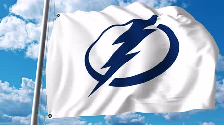 tampa bay : Waving flag with Tampa Bay Lightning NHL hockey team logo. 4K editorial clip