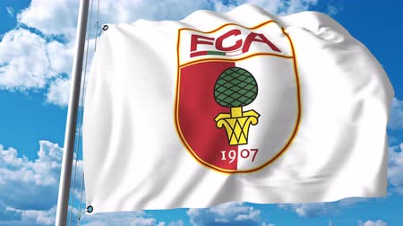 augsburg : Waving flag with FC Augsburg football club logo. 4K editorial clip Stock Footage