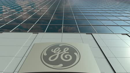 general electric : Signage board with General Electric GE logo. Modern office building facade time lapse. Editorial 3D rendering Stock Footage