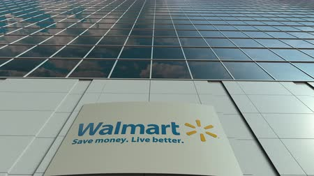 walmart : Signage board with Walmart logo. Modern office building facade time lapse. Editorial 3D rendering