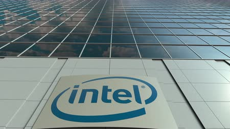 intel : Signage board with Intel Corporation logo. Modern office building facade time lapse. Editorial 3D rendering Stock Footage