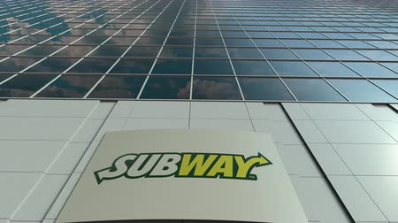 franczyza : Signage board with Subway logo. Modern office building facade time lapse. Editorial 3D rendering