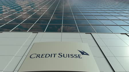 credit suisse : Signage board with Credit Suisse Group logo. Modern office building facade time lapse. Editorial 3D rendering Stock Footage