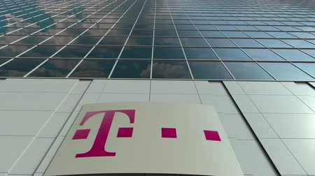 telekomünikasyon : Signage board with T-Mobile logo. Modern office building facade time lapse. Editorial 3D rendering