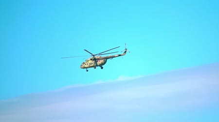 mi : MOSCOW REGION, RUSSIA - JULY 23, 2017. Russian military transport helicopter Mil Mi-17 Hip flying in the sky. Slow motion telephoto lens shot Stock Footage