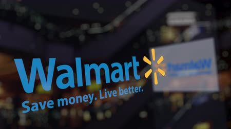 walmart : Walmart logo on the glass against blurred business center. Editorial 3D rendering