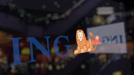 ing : ING Group logo on the glass against blurred business center. Editorial 3D rendering