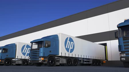 chipset : Freight semi trucks with HP Inc. logo loading or unloading at warehouse dock, seamless loop. Stock Footage
