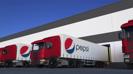pepsico : Freight semi trucks with Pepsi logo loading or unloading at warehouse dock, seamless loop. Stock Footage