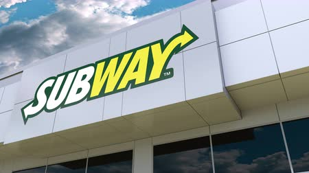 franczyza : Subway logo on the modern building facade. Editorial 3D rendering Wideo