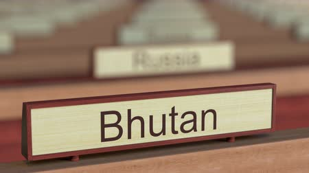 bhutan : Bhutan name sign among different countries plaques at international organization. 3D rendering Stock Footage