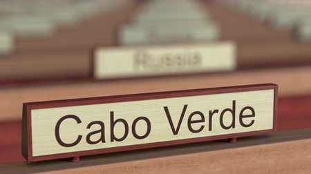 ábrázol : Cabo Verde name sign among different countries plaques at international organization. 3D rendering