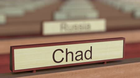 чад : Chad name sign among different countries plaques at international organization. 3D rendering Стоковые видеозаписи