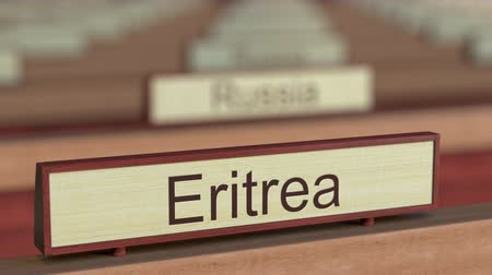ábrázol : Eritrea name sign among different countries plaques at international organization. 3D rendering Stock mozgókép
