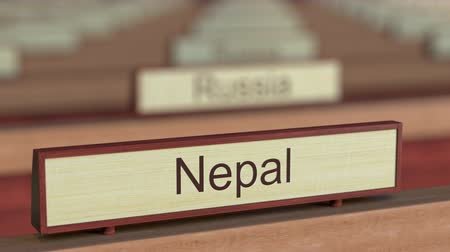 ábrázol : Nepal name sign among different countries plaques at international organization. 3D rendering