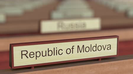 ábrázol : Republic of Moldova name sign among different countries plaques at international organization. 3D rendering