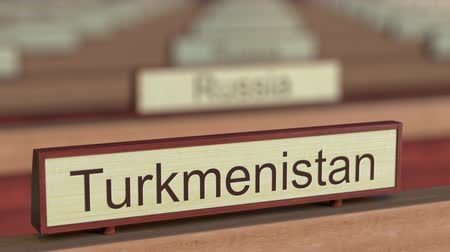 ábrázol : Turkmenistan name sign among different countries plaques at international organization. 3D rendering